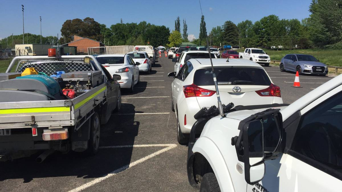 WAITING GAME: Long queues this morning at a free drive-through COVID-19 testing clinic at Cooke Hockey Complex. Photo: ANYA WHITELAW