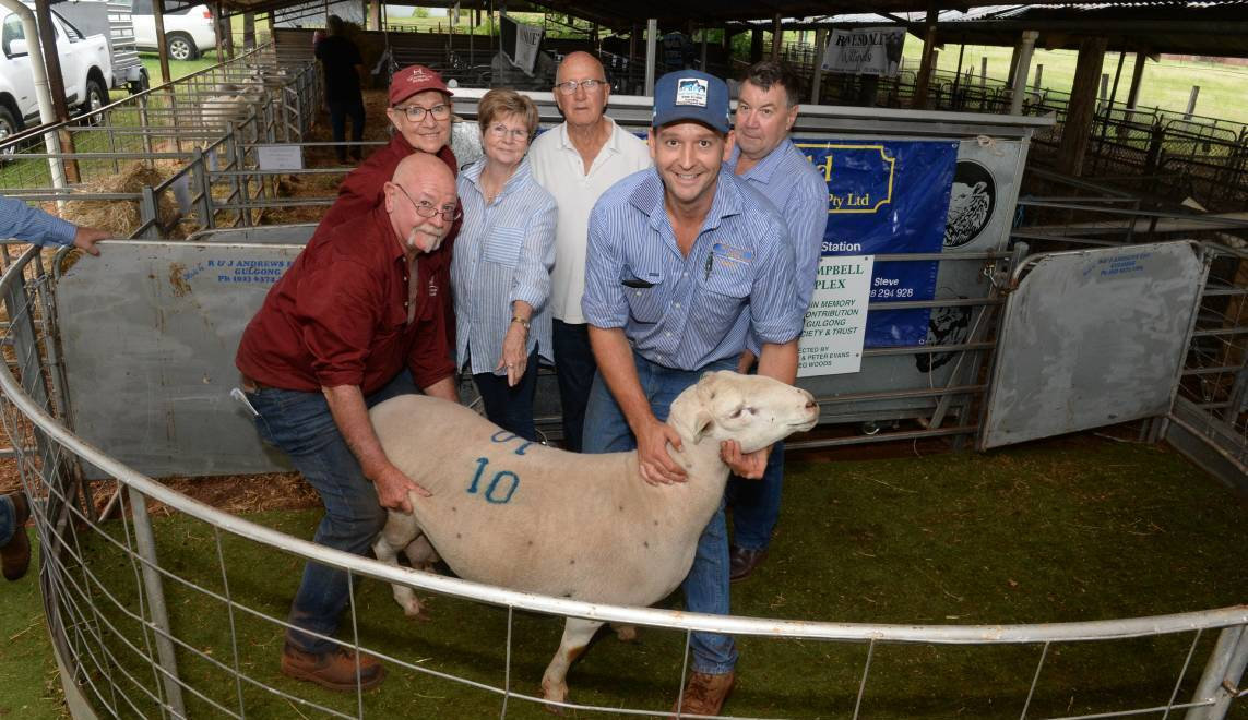 The $3700 record-priced ram with local breeders Julie Huie and Jeff Lucas, Westmoreland stud, Wisemans Creek, buyers Gloria and Des Houlihan, Mandagery View stud, Manildra, and Andy Carter, McDonald Lawson, Mudgee, with a firm hold.