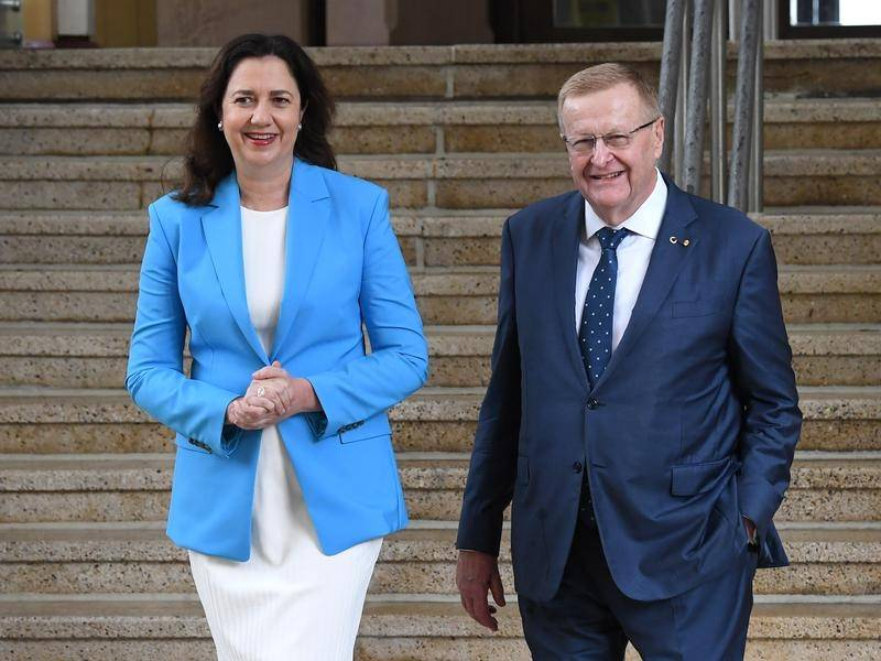 It is a happy day for Queensland Premier Annastacia Palaszczuk and AOC President John Coates.